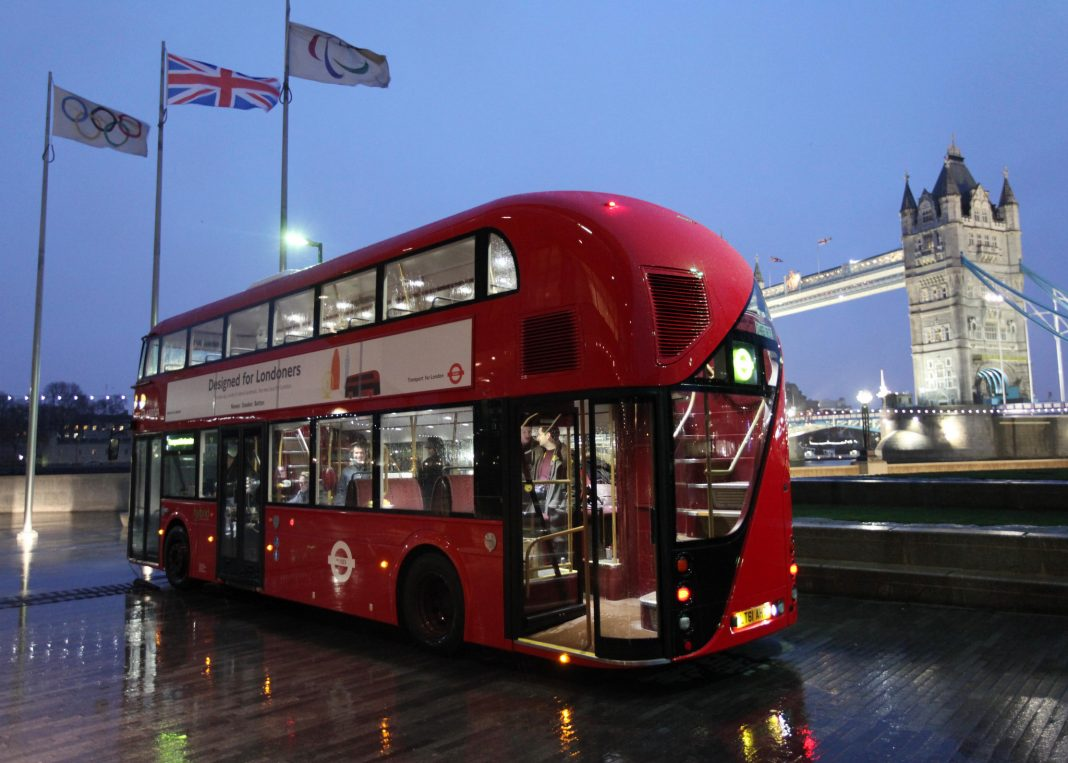 New Bus for London near Tower Bridge at night